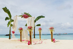 Wedding setup and flowers on tropical beach background Stock Images