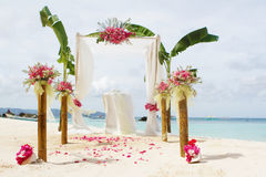 Wedding setup and flowers on tropical beach background Royalty Free Stock Photo