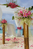 Wedding setup and flowers on tropical beach background Stock Image