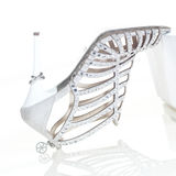 Wedding ring on shoe heel. Upside down female shoe with a wedding ring on the long, high heel Royalty Free Stock Photo