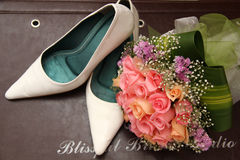 Wedding shoe with flower. Wedding female shoe and flowers Royalty Free Stock Photography