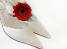 Wedding Shoes. Beautiful satin beaded wedding shoes with a red flower Royalty Free Stock Image
