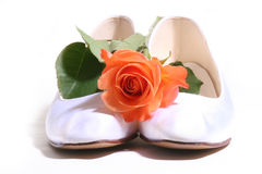 Wedding shoes. White wedding shoes with red rose Stock Images