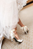 Wedding shoes. Bride walking on the carpet stock photography