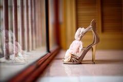Wedding shoes. Beside the window Stock Image