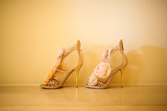 Wedding shoes. In front of the wall Stock Photography