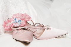 Wedding Shoes. Light Colored wedding shoes on a white gown Stock Photo