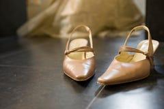 Wedding shoes. Glimps of wedding dress on background Stock Image