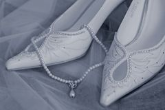 Wedding shoes and beads Royalty Free Stock Photos