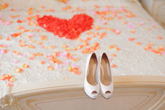 Wedding Shoes on Bed Stock Photo