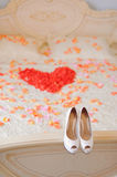 Wedding Shoes on Bed Royalty Free Stock Image