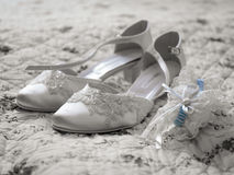 Wedding Shoes and Blue Ribbon. On a white sheet with floral pattern stock photos
