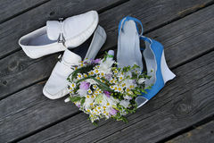 Wedding shoes and bouquet royalty free stock photos