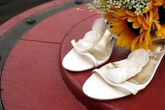 Wedding shoes and bouquet Royalty Free Stock Photo