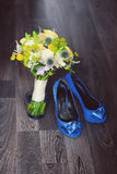 Wedding shoes and bouquet on a dark background Royalty Free Stock Photo