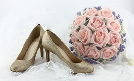 Wedding shoes and a bouquet of flowers Royalty Free Stock Image
