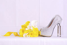 Wedding shoes and bouquet in natural setting. Stock Photography