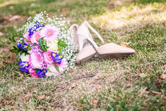 Wedding shoes with bouquet Royalty Free Stock Image