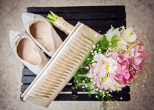 Wedding shoes and bouquet. Top view. Royalty Free Stock Photos