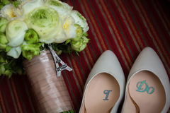 Wedding shoes and bouquet Royalty Free Stock Images