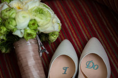 Wedding shoes and bouquet Stock Photo