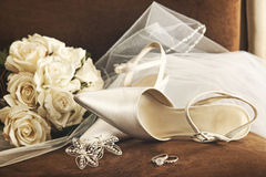 Wedding shoes with bouquet of white roses and ring Royalty Free Stock Photo