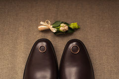Wedding shoes, boutonniere, and ring Stock Photo