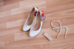 Wedding shoes bracelet and earrings, a necklace Royalty Free Stock Image