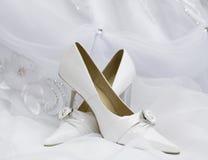 Wedding shoes on bridal dress. Wedding shoes on  white bridal dress Royalty Free Stock Images