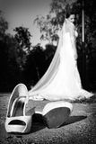 Wedding shoes on bride Stock Photos