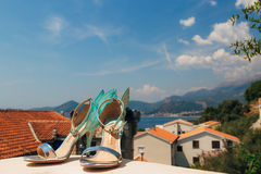Wedding shoes of the bride against the background of mountains and the sea. Stock Image