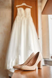 Wedding shoes and bride in a bedroom Stock Photography