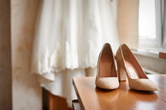 Wedding shoes and bride in a bedroom Royalty Free Stock Images