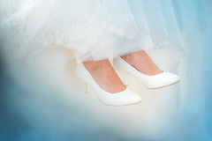 Wedding shoes. Bride in wedding shoes and dress close up Royalty Free Stock Images