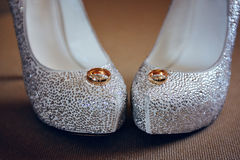 Wedding shoes bride and gold rings Royalty Free Stock Photo