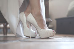 Wedding shoes. The bride puts on beautiful wedding shoes Royalty Free Stock Images