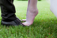 Wedding shoes. Bride's and groom's shoes on the grace Stock Photos
