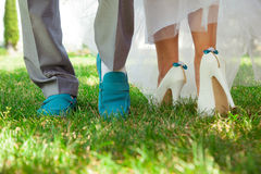 Wedding shoes. Bride's and groom's shoes on the grace Royalty Free Stock Image