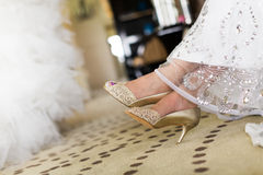 Wedding shoes. The bride sat waiting Stock Photo