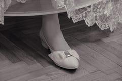 Wedding shoes. The bride shows white wedding shoes Stock Photos
