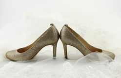 Wedding shoes and a bride veil Royalty Free Stock Photo