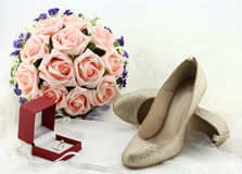 Wedding shoes and a bride veil and a wedding ring Stock Photography