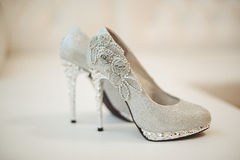 Wedding shoes of the bride. Shoes of the bride on a white background Stock Photos