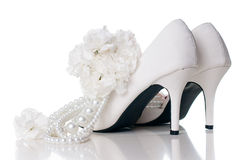 Wedding shoes, carnations and necklace Stock Photos
