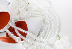Wedding shoes, carnations and necklace Stock Photo
