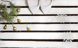 Wedding shoes and Christmas tree branches on wood background Royalty Free Stock Photography