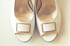 Wedding shoes. Close up image of white wedding shoes stock photos