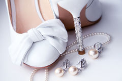 Wedding shoes and costume jewellery. royalty free stock photo