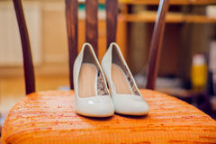 Wedding shoes cream color on the chair Stock Images