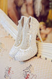 Wedding shoes cream color on the chair Stock Photography